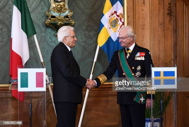 Italian President Sergio Mattarella shakes hands with King Carl XVI Gustaf of Sweden after a press statement on November 13 2018 at the Royal Palace...