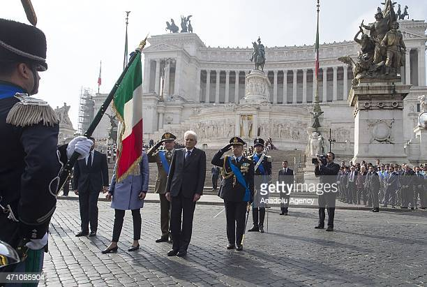Italian President Sergio Mattarella stands in silence after placing wreath on Altare della Patria in Rome on April 25 2015 during an official...
