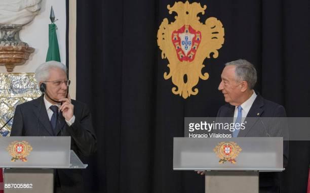 Italian President Sergio Mattarella uses headphones to listen a translation of Portuguese President Marcelo Rebelo de Sousa delivering remarks at the...