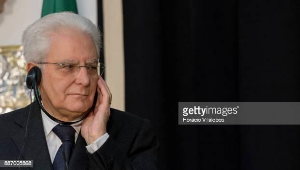 Italian President Sergio Mattarella uses headphones to listen a translation of Portuguese President Marcelo Rebelo de Sousa's remarks at the end of...