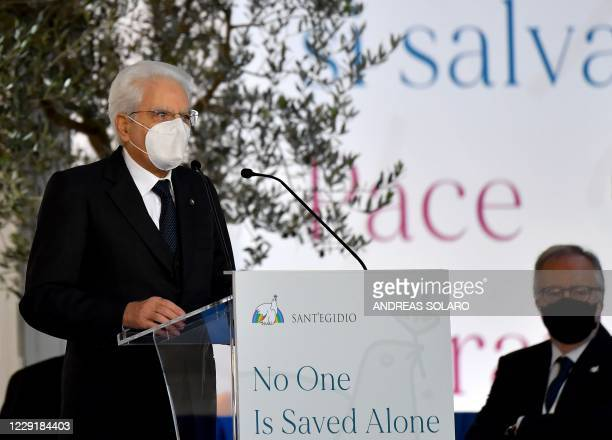 Italian President Sergio Mattarella, wearing a protective face mask, delivers a speech during a ceremony for peace with Pope Francis and...