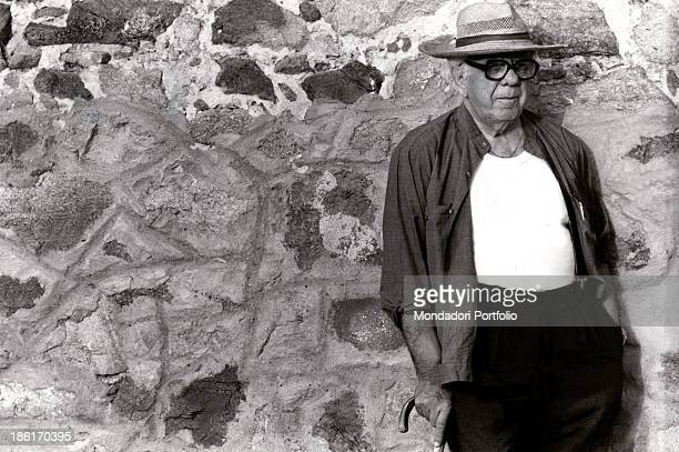 Italian priest Don Zeno Saltini leaning against a wall Don Zeno is the founder of the community for practicing Catholics Nomadelfia Grosseto 1968