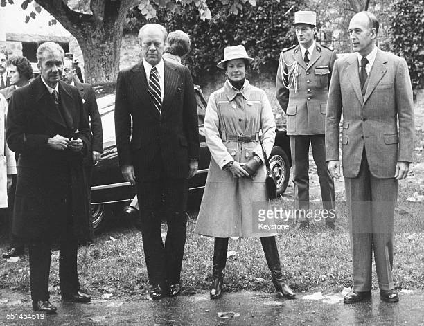 Italian Prime Minister Aldo Moro US President Gerald Ford and French President Valery Giscard d'Estaing with his wife arriving at a summit meeting in...
