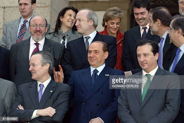 Italian Prime Minister and current Foreign Affairs minister Silvio Berlusconi makes a joke behind Spanish Foreign minister Josep Pique whose country...
