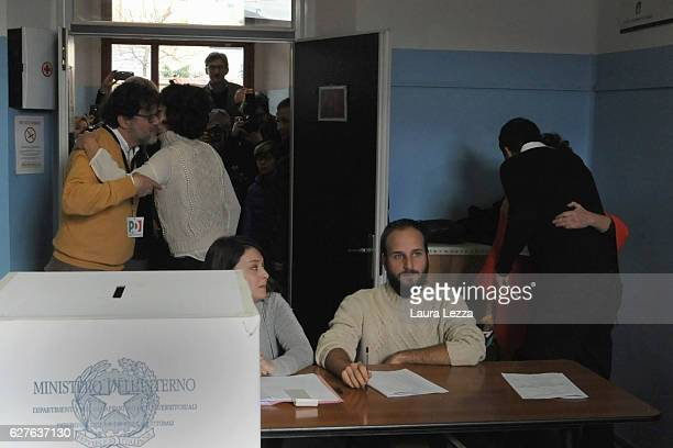 Italian Prime Minister and Democratic Party leader Matteo Renzi and his wife Agnese Renzi greet people after casting their vote for the...