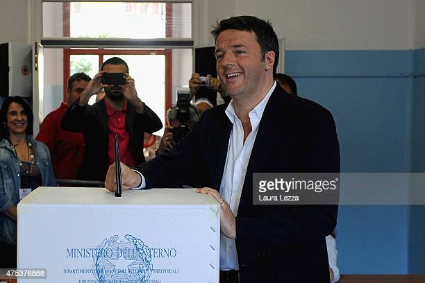 Italian Prime Minister and Democratic Party leader Matteo Renzi casts his vote for the regional election on May 31 2015 in Pontassieve near Florence...