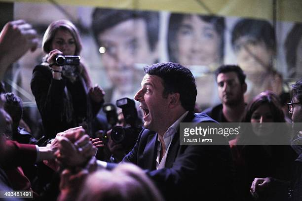 Italian Prime Minister and Democratic Party leader Matteo Renzi greets people after speaking at Piazza della Signoria during his last political rally...