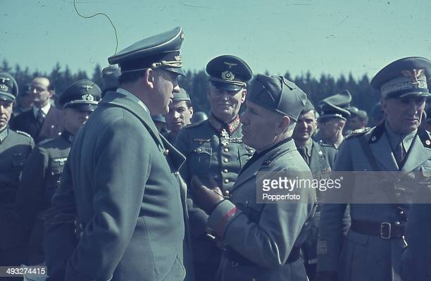 Italian Prime Minister Benito Mussolini meets with Italian commander Rodolfo Graziani and German Field Marshal Wilhelm Keitel during the invasion of...