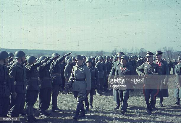 Italian Prime Minister Benito Mussolini reviews Italian troops sent to assist German forces on the Eastern Front during the invasion of the Soviet...
