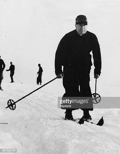 Italian Prime Minister Benito Mussolini skiing down a slope, at Rocca Delle Caminate, Italy, January 5th 1939.
