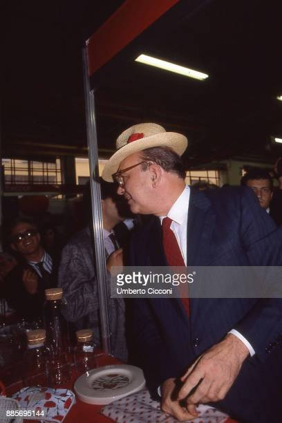 Italian Prime Minister Bettino Craxi wears a hat with the carnation flower on it symbol of the socialist party Milan 1987