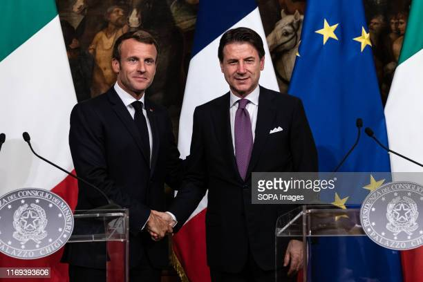 Italian Prime Minister Giuseppe Conte and French President Emmanuel Macron attend a press conference at Palazzo Chigi in Rome