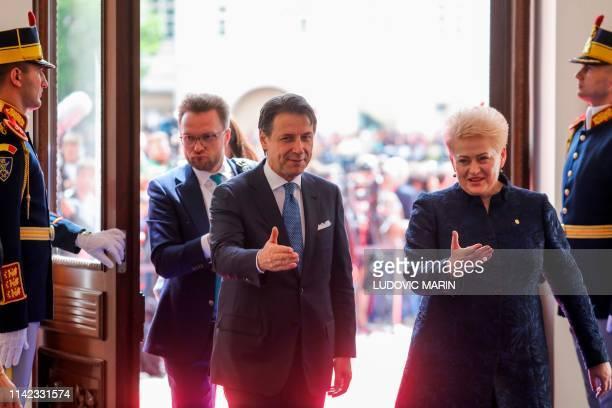 Italian Prime Minister Giuseppe Conte and Lithuania's President Dalia Grybauskaite arrive for a EU summit in Sibiu central Romania on May 9 2019...