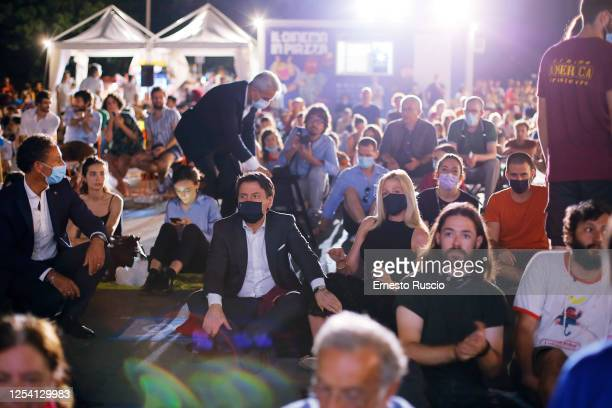 Italian Prime Minister Giuseppe Conte and Olivia Palladino attend the Summer Opening of Cinema America at Piazza San Cosimato on July 03, 2020 in...