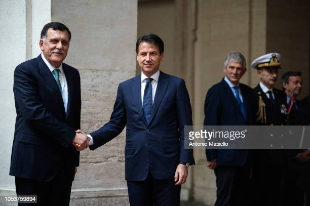 Italian Prime Minister Giuseppe Conte and Prime Minister of the Government of National Accord of Libya Fayez alSarraj shake hands before their...