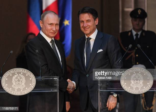 Italian Prime Minister Giuseppe Conte and Russian President Vladimir Putin shake hands after holding a joint press conference following their meeting...