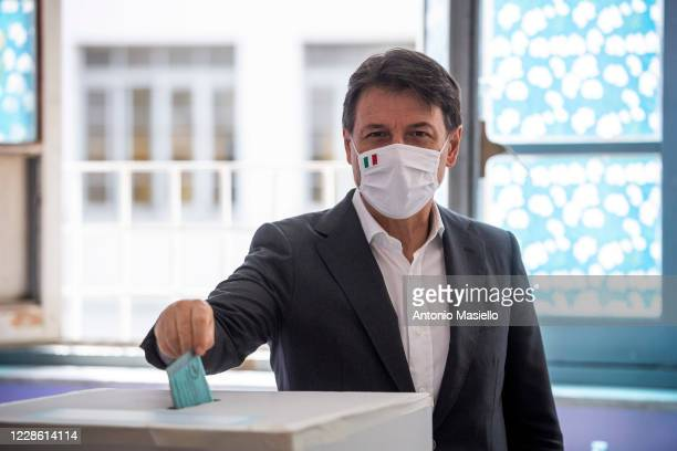 """Italian Prime Minister Giuseppe Conte casts his vote for the constitutional referendum at a polling station in the high school """"Liceo Virgilio"""" on..."""