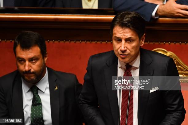 Italian Prime Minister Giuseppe Conte flanked by Deputy Prime Minister and Interior Minister Matteo Salvini delivers a speech at the Italian Senate...