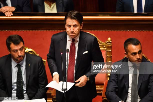 TOPSHOT Italian Prime Minister Giuseppe Conte flanked by Deputy Prime Minister and Interior Minister Matteo Salvini and by Deputy Prime Minister and...