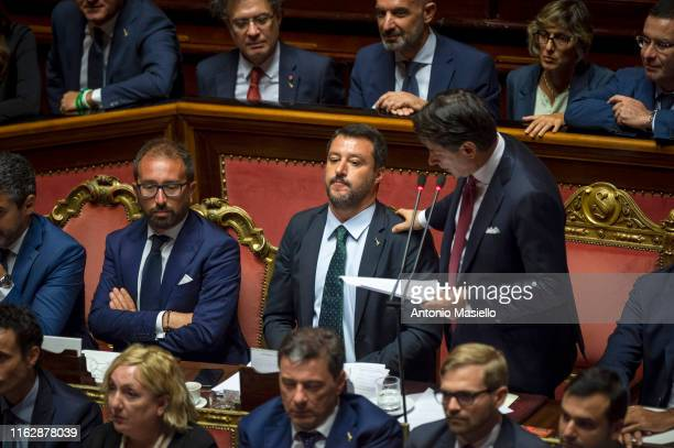 Italian Prime Minister Giuseppe Conte flanked by Labour Minister Luigi Di Maio and Interior Minister Matteo Salvini delivers his speech during the...
