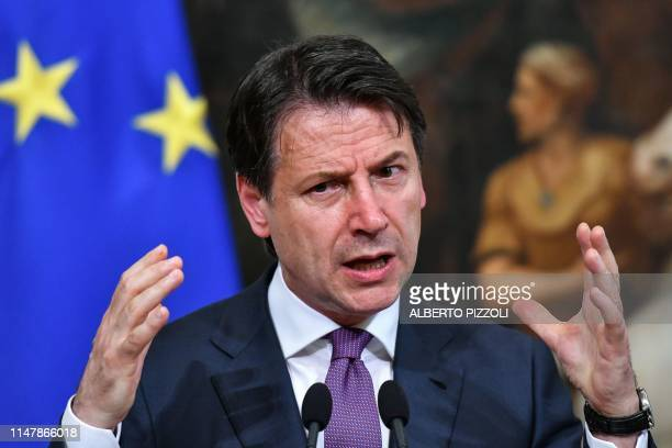 Italian Prime Minister Giuseppe Conte gestures as he speaks during a press conference at Chigi Palace in Rome on June 3 2019