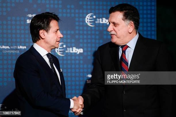 Italian Prime Minister Giuseppe Conte greets head of the UN-backed unity government in Tripoli, Prime Minister Fayez al-Sarraj upon his arrival for a...
