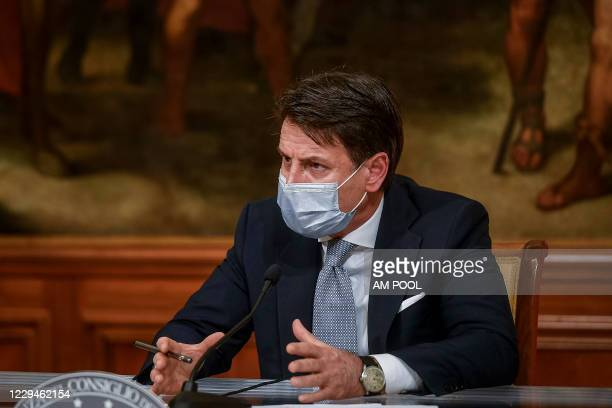 Italian Prime Minister Giuseppe Conte holds a press conference to announce a new emergency decree on Coronavirus restrictions, at Palazzo Chigi, on...
