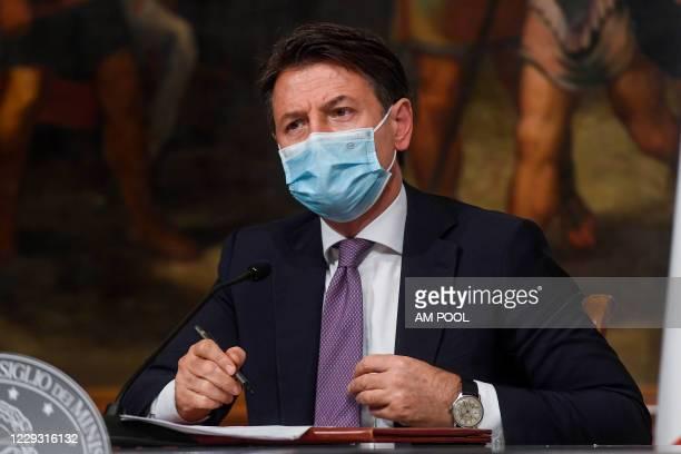 "Italian Prime Minister Giuseppe Conte holds a press conference to present the ""Decreto ristori"" at Palazzo Chigi, on October 28 in Rome, Italy. The..."