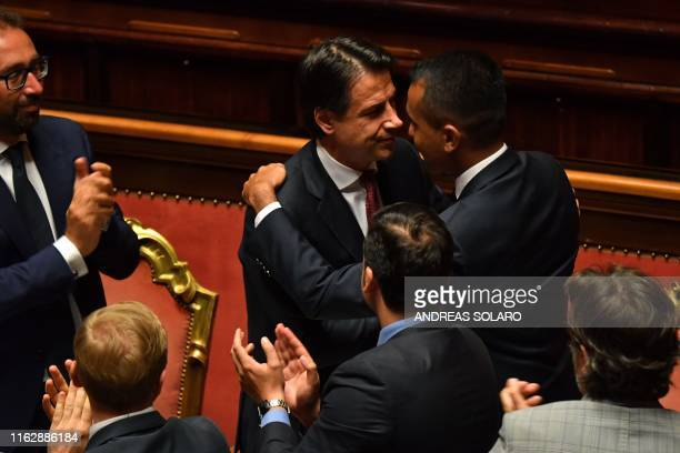 Italian Prime Minister Giuseppe Conte is congratulated after delivering a speech at the Italian Senate in Rome on August 20 as the country faces a...
