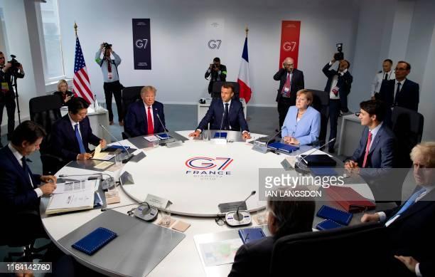 TOPSHOT Italian Prime Minister Giuseppe Conte Japanese Prime Minister Shinzo Abe US President Donald Trump French President Emmanuel Macron German...