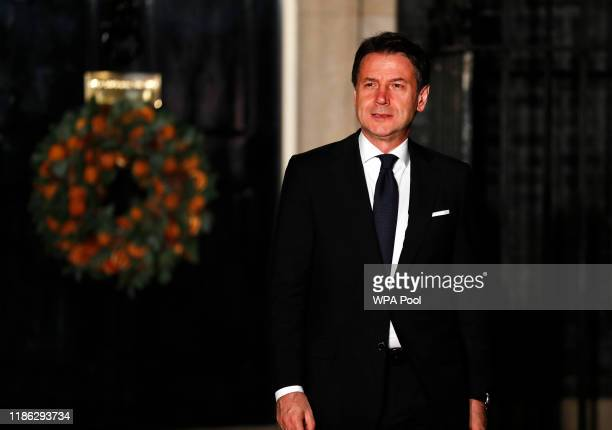 Italian Prime Minister Giuseppe Conte leaves 10 Downing Street after attending a NATO reception hosted by British Prime Minister Boris Johnson on...