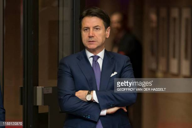 Italian Prime Minister Giuseppe Conte leaves an European Union leaders summit at the Europa building in Brussels on July 1 after it's been adjourned...