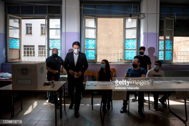 """Italian Prime Minister Giuseppe Conte leaves the polling station after voting in the constitutional referendum in the high school """"Liceo Virgilio"""" on..."""