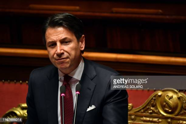 Italian Prime Minister Giuseppe Conte looks on as he delivers a speech at the Italian Senate in Rome on August 20 as the country faces a political...