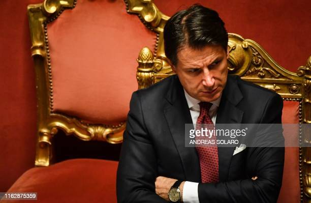 Italian Prime Minister Giuseppe Conte reacts after delivering a speech at the Italian Senate in Rome on August 20 as the country faces a political...