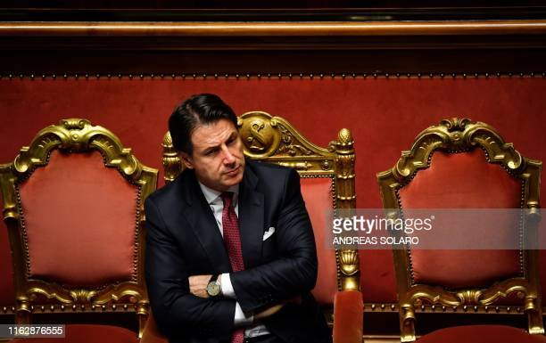 TOPSHOT Italian Prime Minister Giuseppe Conte reacts after delivering a speech at the Italian Senate in Rome on August 20 as the country faces a...