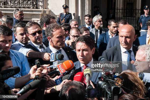 Italian Prime Minister Giuseppe Conte speaks to journalists outside Chigi Palace in Rome on 28 September 2018 Italy's stock market fell sharply...