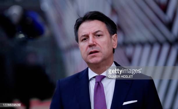 Italian Prime Minister Giuseppe Conte speaks to the press as he arrives on the second day of a European Union summit at The European Council Building...
