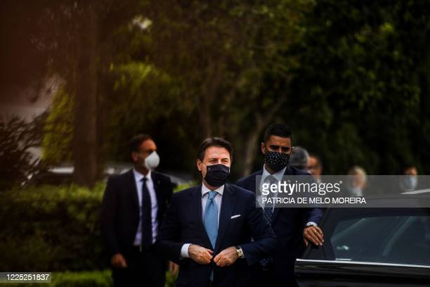 Italian Prime Minister Giuseppe Conte wearing a face mask arrives for a meeting with his Portuguese counterpart at the Sao Bento Palace in Lisbon on...