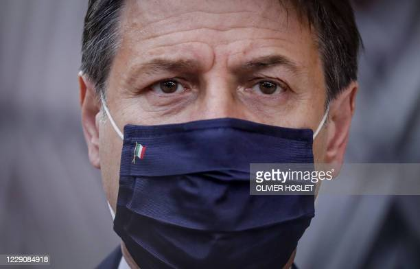 Italian Prime Minister Giuseppe Conte wearing a face mask arrives ahead of a two days European Union summit at the European Council Building in...