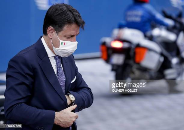 Italian Prime Minister Giuseppe Conte wearing a face mask, arrives on the second day of a two days face-to-face EU summit, in Brussels, on October...