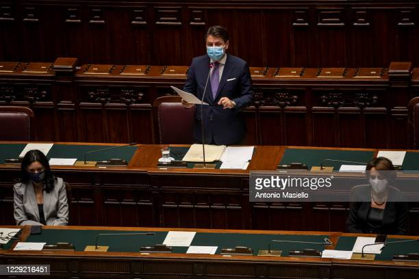 Italian Prime Minister Giuseppe Conte wearing a protective mask delivers his speech during the informative debate about further initiatives adopted...
