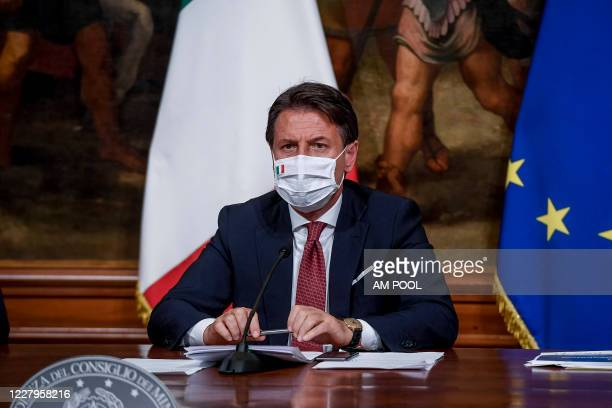 Italian Prime Minister Giuseppe Conte wearing a protective mask holds a press conference after the Cabinet for the decree law August at Palazzo...