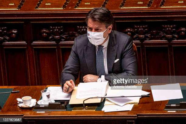 Italian Prime Minister Giuseppe Conte wearing a protective mask attends the debate at the Camera dei Deputati about further initiatives related to...