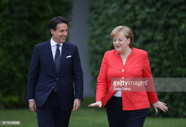 Italian Prime Minister Guiseppe Conte and German Chancellor Angela Merkel depart after giving statements to the media at the Chancellery on June 18...