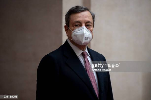 Italian Prime Minister Mario Draghi arrives at Palazzo Chigi before the first Ministry Council meeting of the new Italian government, on February 13,...