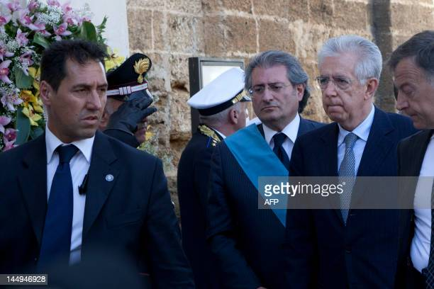 Italian Prime Minister Mario Monti (2D-R° arrives at the church for the funeral service of Melissa Bassi on May 21, 2012 in Mesagne. Italian...