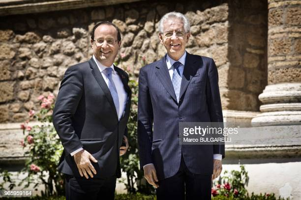 Italian Prime Minister Mario Monti and French President Francois Hollande pose for the photographers in Villa Madama on June 22 2012 in Rome in Italy