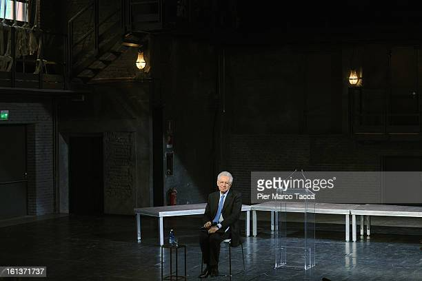 """Italian Prime Minister Mario Monti delivers a speech during a meeting with young people at """" Franco Parenti"""" theater on February 10, 2013 in Milan,..."""
