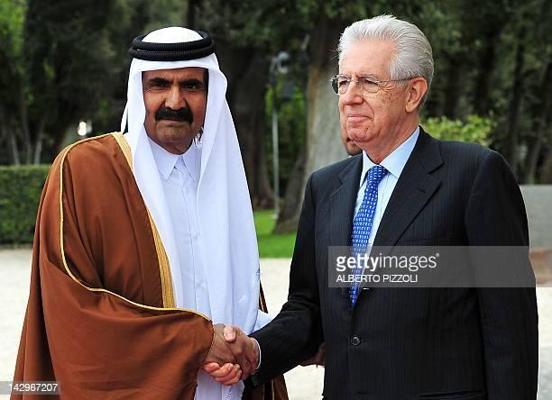 Italian Prime Minister Mario Monti greets Qatari Emir Sheikh Hamad bin Khalifa al-Thani prior their meeting at Villa Pamphili on April 16, 2012 in...